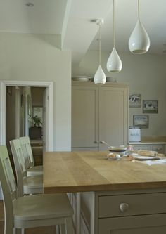 Beautiful painted island and cabinet from Farrow & Ball. Love this earthy putty hue.