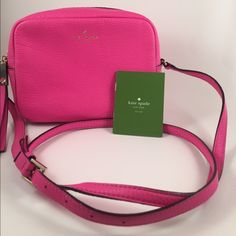 Kate Spade neon pink purse Gorgeous Kate Spade neon pink bag with leather tassel and gold hardware. Long, adjustable strap. kate spade Bags