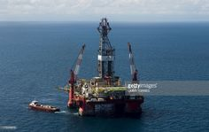 Aerial view of the Centenario exploration oil rig, operated by Mexican company 'Grupo R' and working for Mexico's state-owned oil company PEMEX, in the Gulf of Mexico on August 30, 2013. The semisubmersible platform is able to drill to a depth of 10.000 meters in an enviroment such as the Gulf of Mexico.