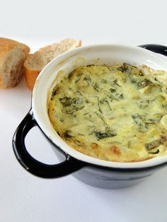 hot spinach and artichoke dip!   Note: Compare to Old Chicago version--  1 cup Parmesan cheese-1c Mozzerella (OR 2 cup parm)--1/3c light mayo--1/3c sour cream--3/4-1c cream cheese--2 tsp minced garlic--1 box frozen spinach (7 oz) thawed--1 (14 oz) can artichoke hearts drained and chopped; heat in crockpot on high 1 hr