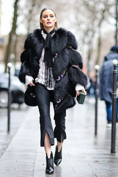 Olivia Palermo wears a black fur coat outside the Giambattista Valli show during Paris Fashion Week Womenswear Fall/Winter 2017/2018 on March 6 2017 in Paris