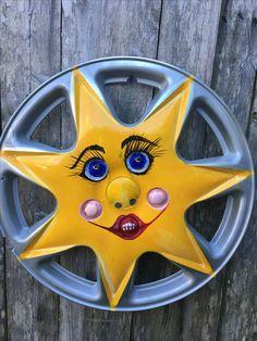 Hubcap art - Ms. Susie Sunshine