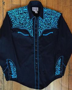 The original maker of the pearl snap western shirt. Rockmount's western wear collection includes vintage embroidered shirts, bolo ties, western hats and silk scarves. Cowgirl Outfits, Western Outfits, Western Shirts, Western Costumes, Cowgirl Shirts, Vintage Western Wear, Vintage Men, Vintage Shirts, Crop Top Shirts