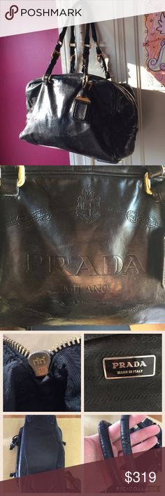 PRADA Smooth Black Leather Shoulder Bag This is a gorgeous black leather bag that sadly I don't use enough! The leather is smooth and has a sheen to it, but is not patent. For an older bag it has kept up remarkably, inside and out. However please see all photos to understand the wear, which is worst at the corners and handles. I zoomed in so the photos make it look worse than it really is; the bag looks beautifully worn in and well constructed when carried. Description continued in comments…