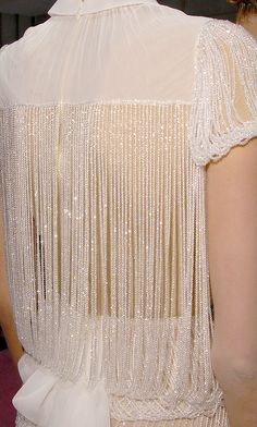 Stunning beaded sheer white blouse.
