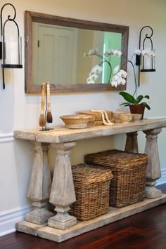 4 boards, 4 newel posts. Paint and distress it all and you have an easy, no-build console table.