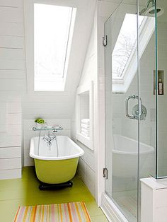 Though perhaps green isn't the most typical colour for the bathroom, we think this lime floor and bath combination brightens up the bathroom no end! Kudos for the stripy bath-mat too. LOVE this room.