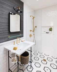 From the subway tile paired with the chic, gray-striped wallpaper to the minimal sink featuring striking gold hardware, every detail of this bathroom is perfection.