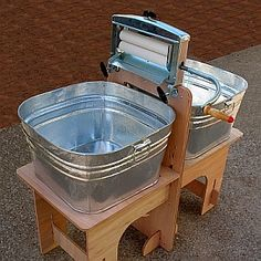 Modern wringer washer Washtub stand easily assembled for use and quickly comes apart for storage Wringer is strong and adjustable Square 15 gallon steel tubs Packs small for storage
