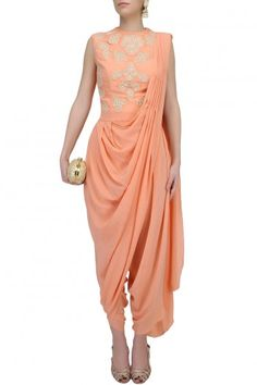 Amrita KM presents Peach draped dhoti saree with peach thread embroidered bodysuit available only at Pernia's Pop Up Shop. Indian Gowns Dresses, Pakistani Bridal Dresses, Indian Fashion Dresses, Indian Designer Outfits, Indian Outfits, Designer Dresses, Designer Wear, Ladies Dresses, Indian Clothes