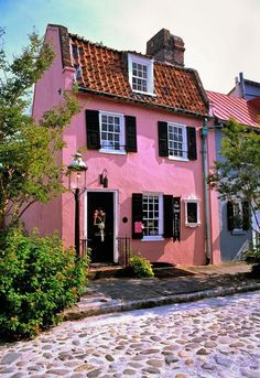 pink cottage-17 Chalmers Street. Built in 1695 and located on a charming cobblestone street, this is Charleston's second oldest structure. It initially housed John Breton's tavern and brothel and is now an art gallery.