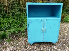 Distressed vintage cupboard in turquoise.  1 available. By bAd ALiCe.