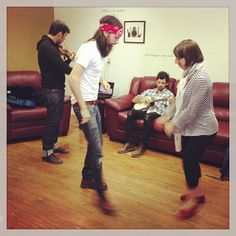 Seth learning to tap dance while Scotty casually strums the banjo