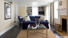 Designers Pat Healing and Dan Barsanti had the task of updating a long, narrow living room in Westport, Connecticut. The back-to-back sofa arrangement created long corridors on either side that accentuated the tunnel effect. Francesco Lagnese  - HouseBeautiful.com