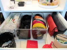 Loving the clear IKEA spice racks for organizing belts and scarves.