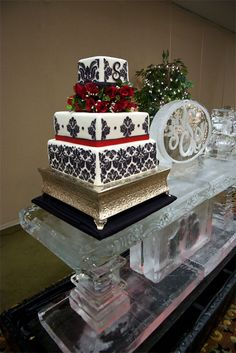Christmas Wedding Cake served on an ice sculpture table in Asheville, NC.  Square Damask Black, White and Red Wedding Cake