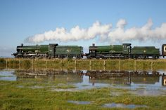 GWR 4-6-0 no 4936 Kinlet Hall and GWR 4-6-0 no 7828 Norton Manor at a flooded Ker Moor on 6 October 2012.
