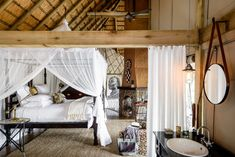 Tented and furnished upscale safari camp bedroom decor from lodge hotels in Zambia, South Africa and Tanzania.