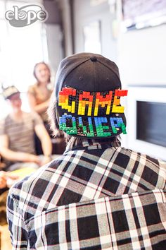 It's GAME OVER for summer boredom! Location: Cafe Velo Photographer: Scott Majors LLC Videographer: Michael Lee Ring, Films About Love Stylists: Boopsie's Beauty Boutique and elope, Inc. Lego Hat, Rainbow Blocks, Summer Boredom, Beauty Boutique, Films, Stylists, Game, Ring, Black