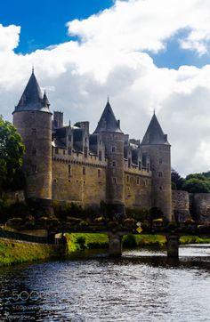Charming Josselin Castle with its nine towers overlooking the...  sky river travel clouds tourist france walls holiday touring battlements Castle Josselin Prizia
