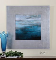 """Uttermost Cancun. The soothing serenity of this print is accented by an 8"""" wide, flat profile frame that is finished in champagne silver leaf with a light brown glaze."""