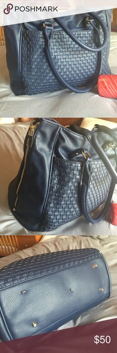 """Deux lux large bag Dark navy large tote handbag Very Romney . Works as a weekend bag or sleep over , can be used as a diaper bag as well. It's pretty big can hold a lot of stuff. It has gold zippers on both sides to enlarge the bag. Has a front pocket . Used but no major wears . The metals stops at the bottoms normally five but there are 3 of them lost the caps but still hanging there. It has a small scuff at one edge see third photo. Dimensions 13""""long ,14"""" wide,5""""deep Can be wider 2 to 3""""…"""