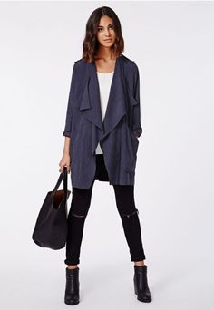 Slip on this hyper modern, deconstructed #trenchcoat when you want to look sharp and on the fashion pulse. In soft and light brushed fabric, with asymmetric patch pockets, a #waterfall collar and adjustable roll-up sleeves you'll be overloaded with luxe in this one. Style it over a bodycon midi dress and skyscraper courts for a seductive twist on the utilitarian trend.