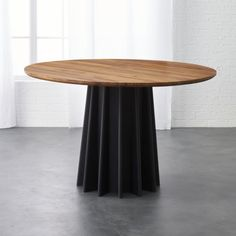 Shop shoreditch dining table.   Named after London's hippest neighborhood, designer Leonhard Pfeifer's table pleats a modern pedestal with masculine edge.