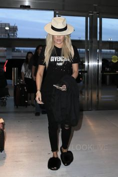 Khloé Kardashian wearing Givenchy Logo Print T-Shirt, Givenchy Mink Fur Slides