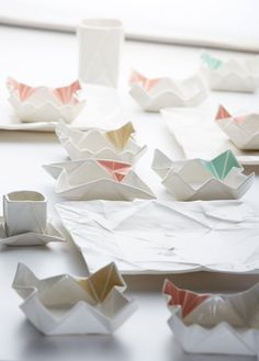 Hamburg-based ceramic artist Angelina Erhorn of Moij Design creates all matter of ceramic dishware that mimics the form of paper origami sheets, both folded and unfolded. Her designs include plates, espresso cups, and vases with delicate creases and occasional stained geometric elements. You can see