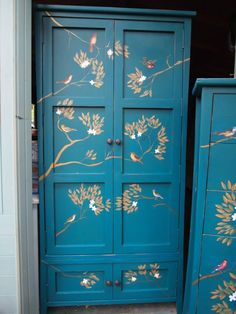 Vintage wardrobe painted in teal, distressed and the decorated in birds and gold leaves using the decoupage technique.