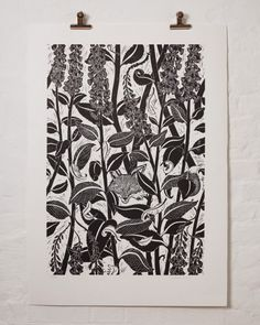 hand block print by Cameron Short is inspired by the tension in nature between beauty and violence; on first glance, we're confronted by the hypnotic gaze of a dog fox, veiled by foxgloves – peer closer and we notice he's licking his lips as the remnants of his supper float away on the evening air.