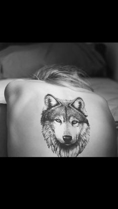 Love, love, love this tattoo! Wolf on the back:)