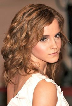 Emma Watson waves.  Article on link about growing up with wealth & fame is interesting as well.