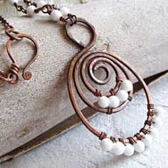 A spiral: mystical and ancient shape, natural way in which plants and animals grow, magic shape made by men...
