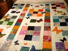 Colourful patchwork quilt with applique butterflies, lap quilt, single bed topper, throw rug, baby quilt, home decor, modern patchwork quilt - pinned by pin4etsy.com