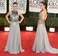 Mila Kunis looked chic in a silver Gucci Premiere gown with an embellished halter at the 71st annual Golden Globe Awards on Jan. 12, 2014.