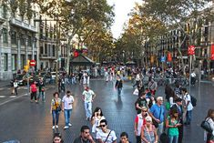 Day and night, La Rambla is crowded with pedestrians walking between Plaza Catalunya and the Waterfront in Barcelona, Spain