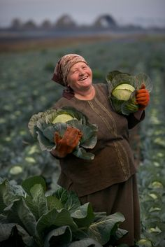 Olexandra Salo with her cabbage near Lviv, Ukraine. She looks like she's having a good belly laugh.