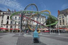 Hundreds of Colorful Café Chairs Take the Form of a Winding Roller Coaster in the Middle of a French Square