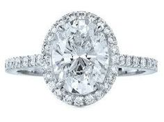 A fancy setting with diamond side stones adds an extra sparkle to your ring and complements your center stone. Smaller diamonds are mounted along the  band in a channel setting. The center stone here is an oval cut diamond. http://fashionaccessoryshop.com/the-engagement-ring.html #engagementring