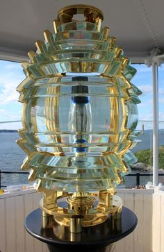 This beautiful reproduction Fresnel lens now sits in the lantern room of the Rose Island Lighthouse in Newport, Rhode Island.