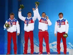 Sochi 2014 Day 11 - Medal Ceremony Silver medalists Dmitriy Japarov, Alexander Bessmertnykh, Alexander Legkov and Maxim Vylegzhanin of Russia celebrate on the podium during the medal ceremony for the Cross Country Men's 4 x 10 km Relay on day 11 of the Sochi 2014 Winter Olympics at the Medals Plaza