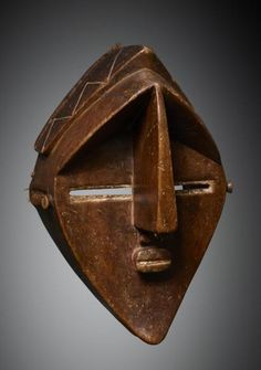 Africa | Mask from the Lwalwa people of DR Congo | Wood, reddish brown patina, with remains of white pigment | Bangongo
