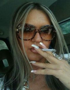 Glasses smoking cigarette a teen in