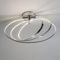 Plafón HALO cromo - Lámpara muy moderna que consta de tres anillos de diferentes tamaños, los dos interiores pueden rotar. Esta lámpara permite crear diferentes ambientes con el movimiento de los anillos. Este modelo lleva los LEDs integrados lo que lo hace muy eficiente y económico.