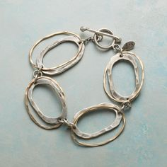 """LINKOLOGY BRACELET--The classic chain link bracelet redefined with ovals within ovals of hammered sterling silver and 14kt gold filled, all fastened by a handcrafted sterling toggle. USA. Exclusive. 7""""L."""