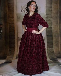 Our rose gown from the latest haute couture collection; in a luxurious shade of deep burgundy.