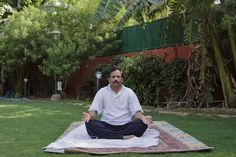 'Shripad Naik, India's first minister overseeing yoga and traditional medicine, practicing yoga in the garden at his residence.' | photo: Kuni Takahashi for The New York Times