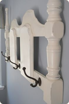 Coat rack for the entryway made out of a headboard.  Can probably use this idea for the kitchen too.  Use it to hang utensils and pots.